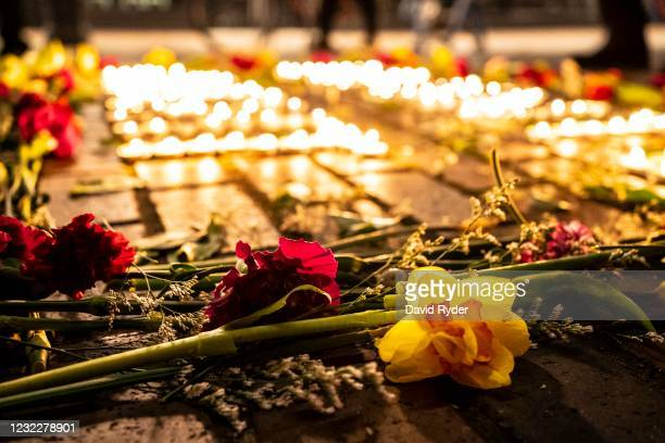 Demonstrators light candles and lay flowers during a vigil for Daunte Wright on April 12, 2021 in Seattle, Washington. Wright, a Black man whose car...