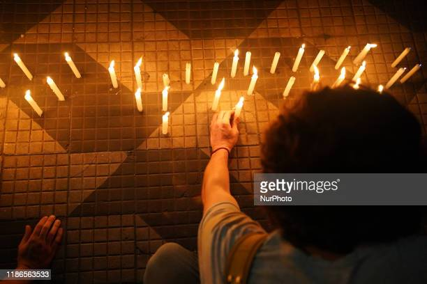 Demonstrators light candles during a protest about the death of nine people during a police raid at a Funk Party at Paraisopolis slum last weekend....