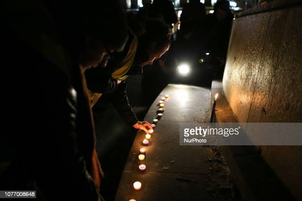 Demonstrators light up candles during a gathering of the quotYellow Vestsquot place de la Republique in Paris on January 3 in tribute to the dead...