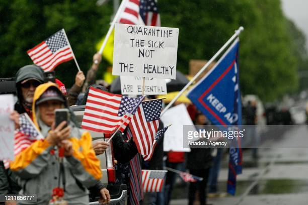 Demonstrators line the street during the protest at the State Capitol in Salem Oregon United States on May 2 2020 Demonstrators protested Oregonâs...