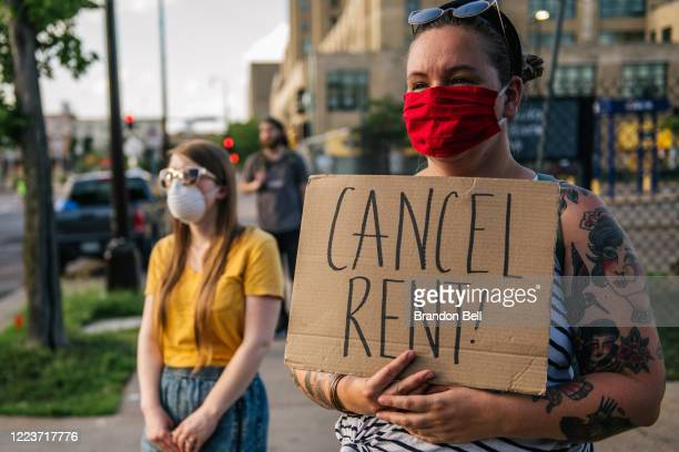 Demonstrators listen during the Cancel Rent and Mortgages rally on June 30, 2020 in Minneapolis, Minnesota. The rally was organized to demand the...