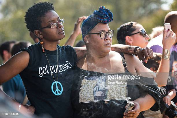 Demonstrators listen to a speaker during a rally at Marshall Park September 24 2016 in uptown Charlotte North Carolina Protests have disrupted the...
