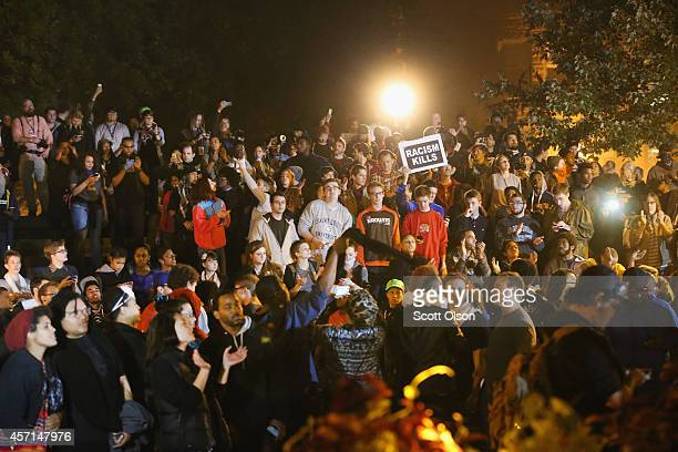 Demonstrators listen to speakers during a rally on the campus of Saint Louis University on October 13 2014 in St Louis Missouri The St Louis area has...