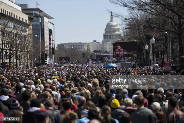 Demonstrators listen to speeches on Pennsylvania Avenue as the US Capitol building stands in the background during the March For Our Lives in...