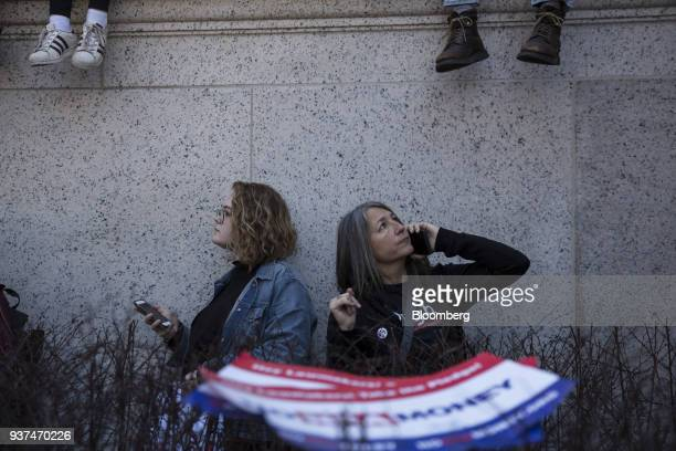 Demonstrators listen to speeches on Pennsylvania Avenue during the March For Our Lives in Washington DC US on Saturday March 24 2018 Thousands of...