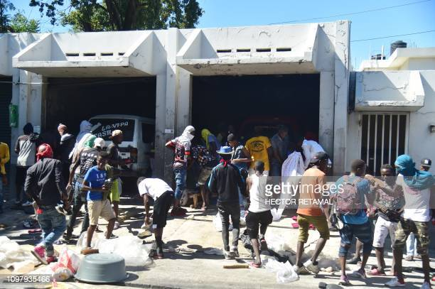 Demonstrators loot a store on the fifth day of protests in PortauPrince February 11 against Haitian President Jovenel Moise and the misuse of...