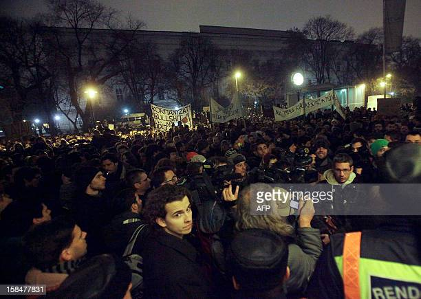 Demonstrators made up of university students teachers doctors and artists shout antigovernment slogans in central Budapest on December 17 2012...