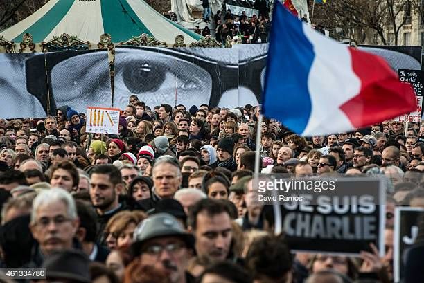 Demonstrators make their way along Boulevard Voltaire during a mass unity rally following the recent terrorist attacks on January 11 2015 in Paris...