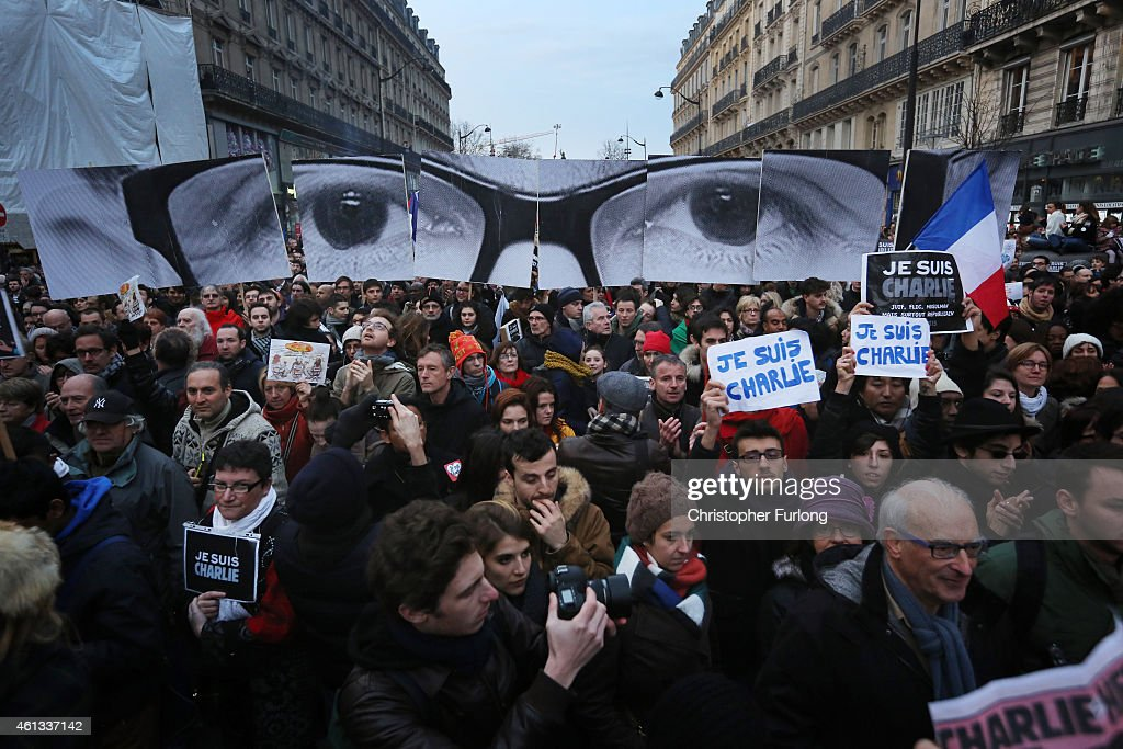Demonstrators make their way along Boulevard Voltaire in a unity rally in Paris following the recent terrorist attacks on January 11, 2015 in Paris, France. An estimated one million people are expected to converge in central Paris for the Unity March joining in solidarity with the 17 victims of this week's terrorist attacks in the country. French President Francois Hollande will lead the march and will be joined by world leaders in a sign of unity. The terrorist atrocities started on Wednesday with the attack on the French satirical magazine Charlie Hebdo, killing 12, and ended on Friday with sieges at a printing company in Dammartin en Goele and a Kosher supermarket in Paris with four hostages and three suspects being killed. A fourth suspect, Hayat Boumeddiene, 26, escaped and is wanted in connection with the murder of a policewoman.