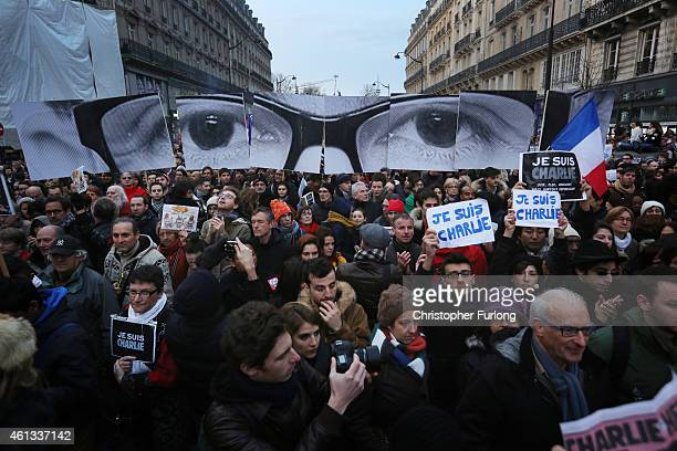 Demonstrators make their way along Boulevard Voltaire in a unity rally in Paris following the recent terrorist attacks on January 11, 2015 in Paris,...
