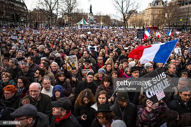 Demonstrators make their way along Place de la Republique during a mass unity rally following the recent terrorist attacks on January 11, 2015 in...