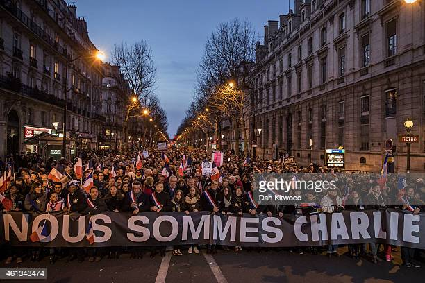 Demonstrators make their way along Place de la Republique during a mass unity rally following the recent terrorist attacks on January 11 2015 in...