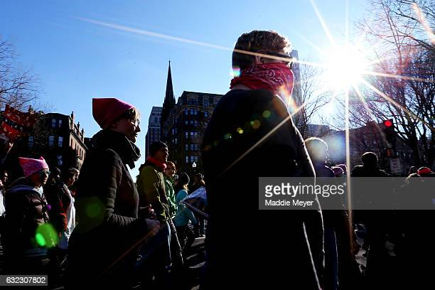 Demonstrators make their way down Commonwealth Avenue during the Boston Women's March for America on January 21, 2017 in Boston,...