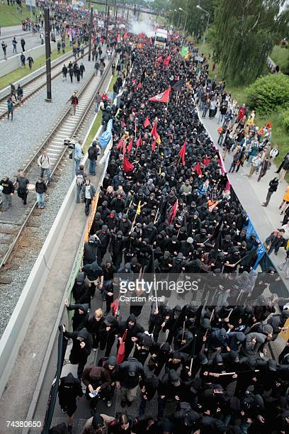 Demonstrators make their way through the city during the Opening Demonstration of G8 opponents on June 2 2007 in Rostock Germany Roughly 25000 people...