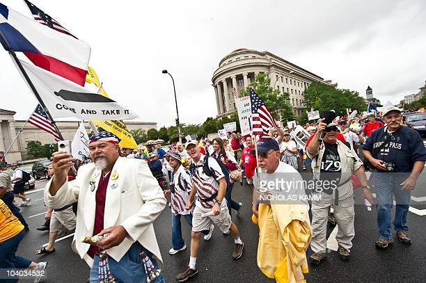 Demonstrators make their way to the US Capitol during a march of supporters of the conservative Tea Party movement in Washington on September 12 2010...