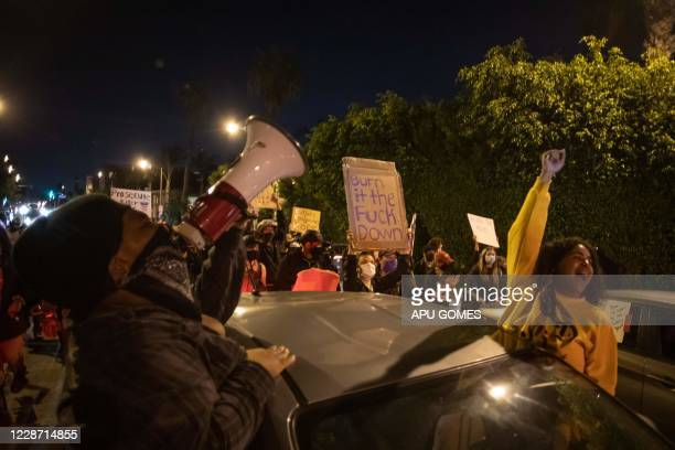 Demonstrators manifest their discontent during a protest over the lack of criminal charges in the police killing of Breonna Taylor in West Hollywood...