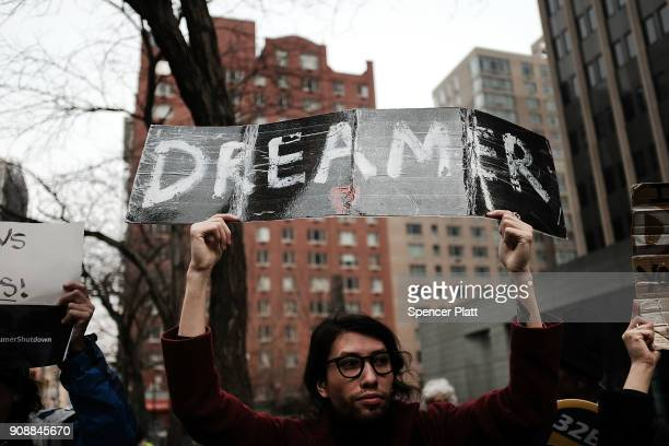 Demonstrators many of them recent immigrants to America protest the government shutdown and the lack of a deal on DACA outside of Federal Plaza on...