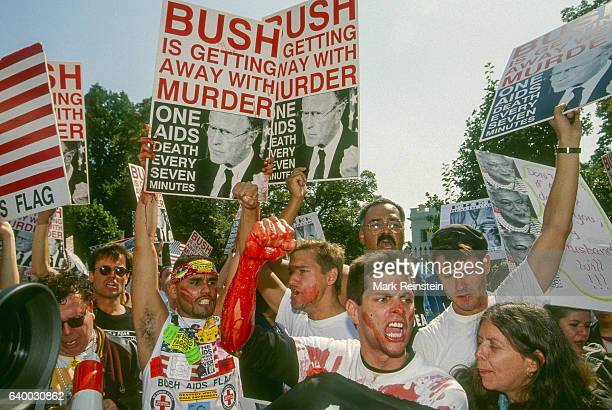 demonstrators many smeared in fake blood carry signs and march in front of the White House Washington DC September 30 1991 Among the visible signs...