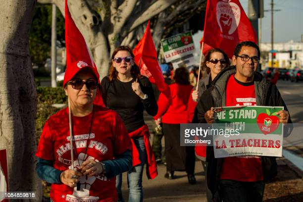 Demonstrators march a picket line during a teachers strike outside of Hamilton Heights High School in Los Angeles California US on Friday Jan 18 2019...