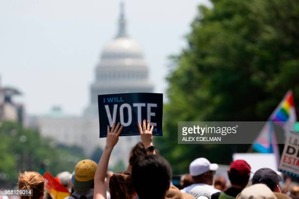 Demonstrators march against the separation of immigrant families on June 30 2018 in Washington DC Demonstrations are being held across the US...
