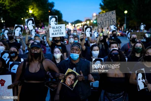 Demonstrators march along Constitution Avenue in protest following a Kentucky grand jury decision in the Breonna Taylor case on September 23 2020 in...