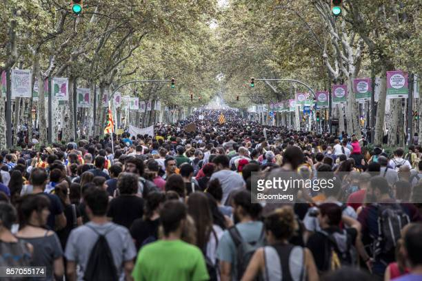 Demonstrators march along Gran Via avenue during a protest and general strike in Barcelona Spain on Tuesday Oct 3 2017 Separatist activists are...