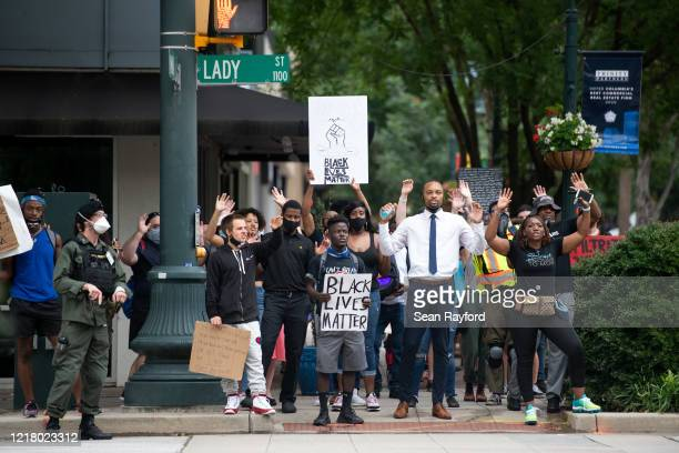 Demonstrators march along Main St. On June 6, 2020 in Columbia, South Carolina. This is the 12th day of protests since George Floyd died in...