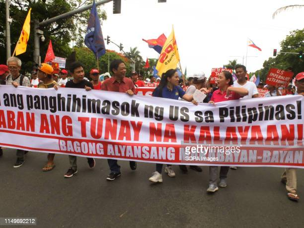 BOULEVARD MANILA PHILIPPINES Demonstrators march along Roxas Boulevard going to US Embassy in Manila during the independence day protest The 121st...