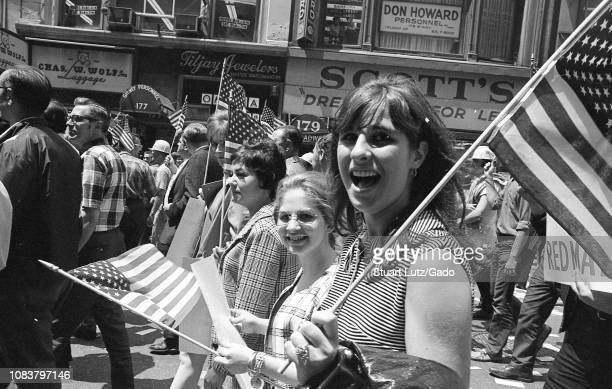 Demonstrators march and hold banners and flags while participating in protests related to the anti-Vietnam War Hard Hat Riot, New York City, New...