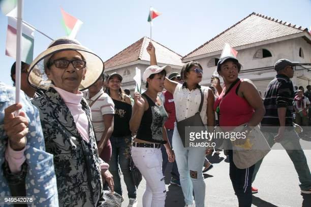 Demonstrators march and wave flags during a opposition demonstration against a draft electoral law already adopted by Madagascar's National Assembly...
