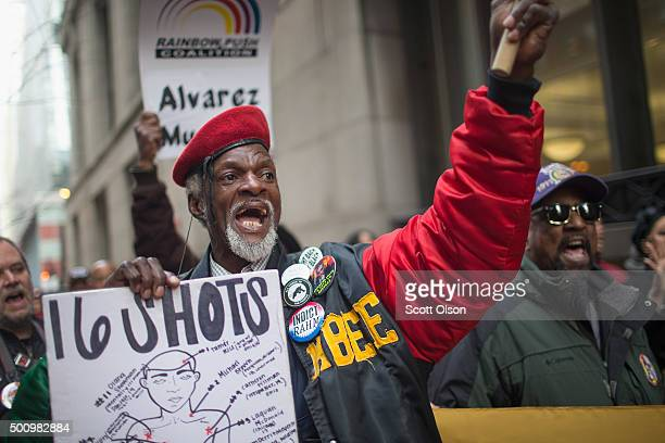 Demonstrators march around City Hall calling on Mayor Rahm Emanuel to resign on December 11 2015 in Chicago Illinois A recently released video of the...