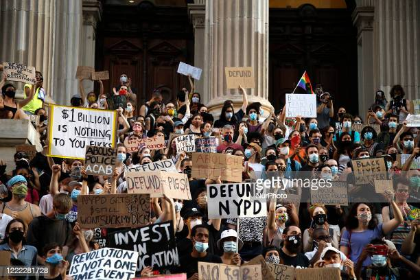 Demonstrators march around City Hall demanding that the city defund the NYPD, in New York City US on June 23, 2020. Mayor Bill de Blasio pledged to...