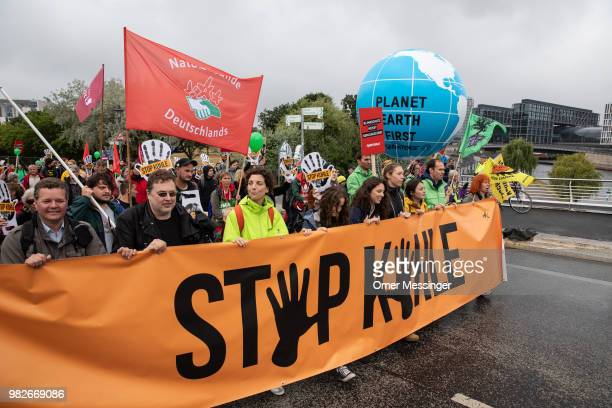 Demonstrators gather to protest against coalbased energy in front of the Chancellery in the 'Stop Coal' protest event on June 24 2018 in Berlin...