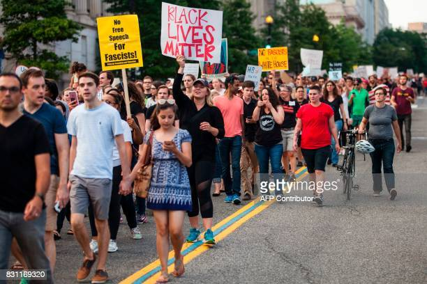 Demonstrators march August 13 2017 to a statue of Confederate General Albert Pike the only member of the Confederate military with an outdoor statue...