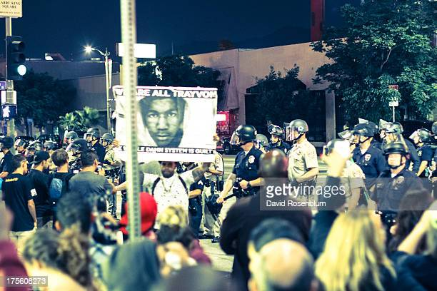 Demonstrators march down Hollywood Boulevard in Los Angeles, CA to protest the not guilty verdict of George Zimmerman in the Trayvon Martin murder...