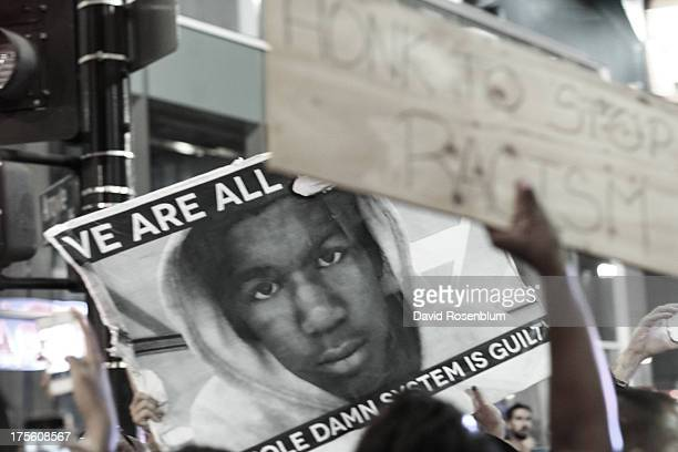 CONTENT] Demonstrators march down Hollywood Boulevard in Los Angeles CA to protest the not guilty verdict of George Zimmerman in the Trayvon Martin...