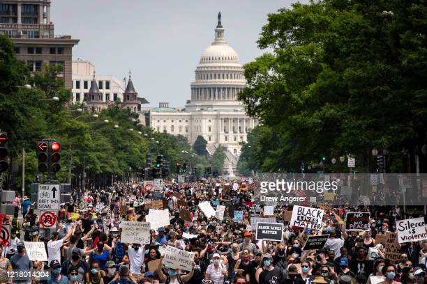 Demonstrators march down Pennsylvania Avenue during a protest against police brutality and racism on June 6 2020 in Washington DC This is the 12th...