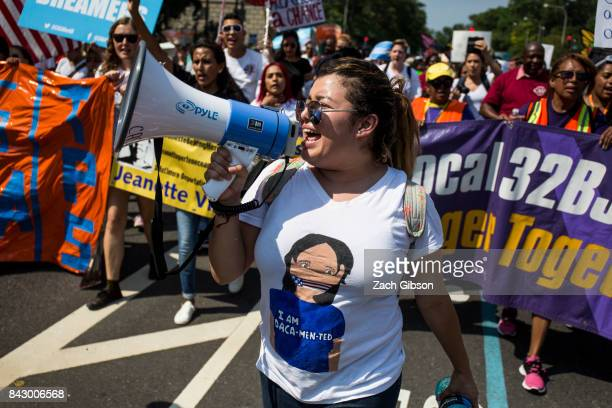 Demonstrators march during a demonstration in response to the Trump Administration's announcement that it would end the Deferred Action for Childhood...