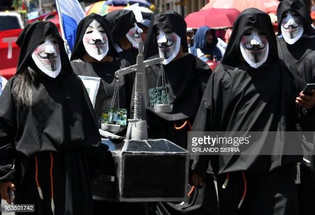 TOPSHOT Demonstrators march during a May Day protest demanding the resignation of President Juan Orlando Hernandez in Tegucigalpa on May 1st 2018