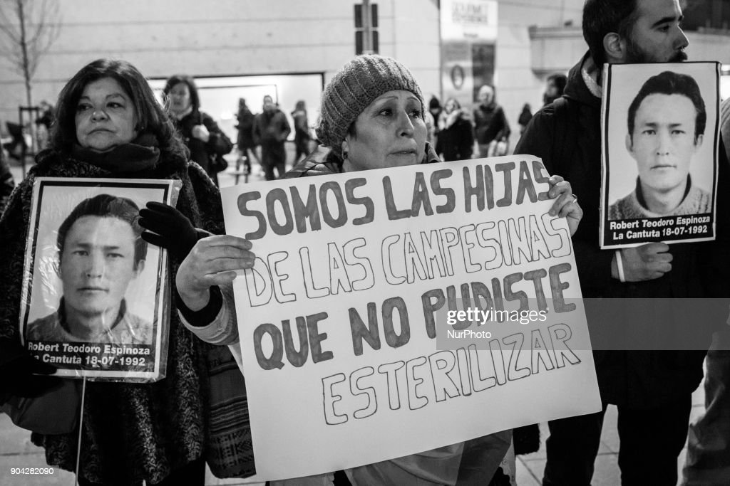 Demonstrators march during a protest against the a controversial pardon granted by Peruvian President Pedro Pablo Kuczynski to former President Alberto Fujimori, in Madrid, on January 12, 2018.