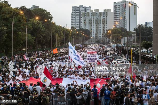 Demonstrators march during a protest against the pardon granted by Peruvian President Pedro Pablo Kuczynski to former President Alberto Fujimori in...