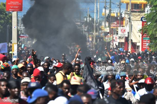 Demonstrators march during a protest demanding accountability from politicians for allegedly squandering billions of dollars in proceeds from...