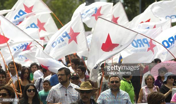 Demonstrators march during a protest demanding the creation of a constituent assembly to amend the 1980 constitution imposed by Chilean dictator...