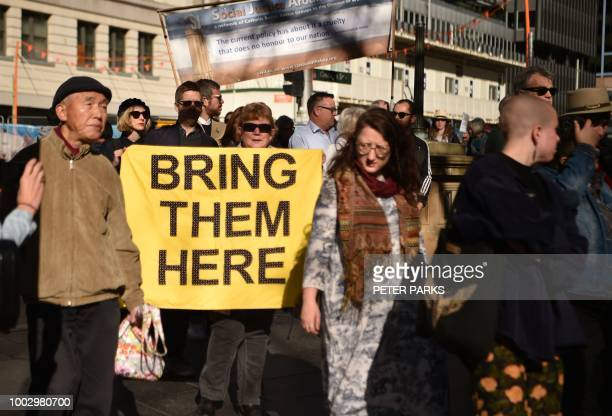 Demonstrators march during a protest to demand humane treatment of asylum seekers and refugees in Sydney on July 21 2018 Australia's detention of...