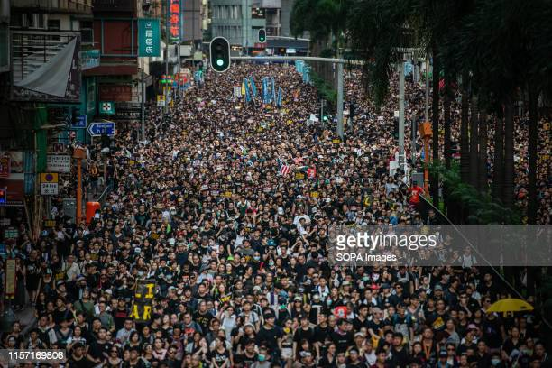 Demonstrators march during Civil Human Rights Front march in Wan Chai Hong Kong China on Sunday July 21 2019 Hong Kong demonstrators gathered for...