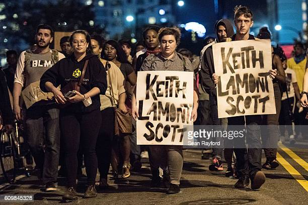 Demonstrators march during protests September 22 2016 in Charlotte North Carolina Protests began on Tuesday night following the fatal shooting of...