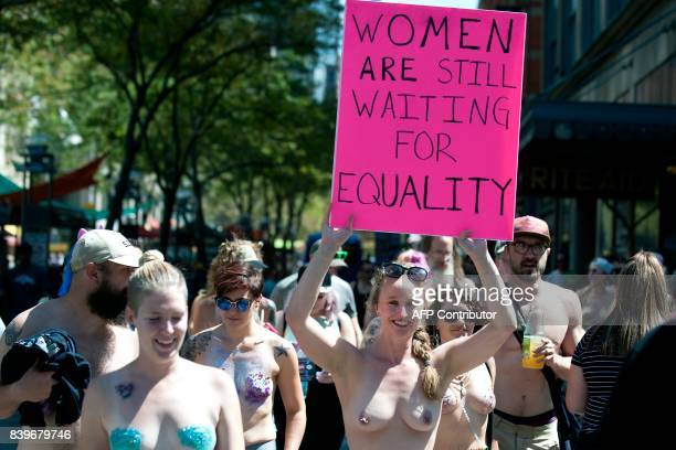Demonstrators march during the 2017 GoTopless Day Parade on August 26 2017 in Denver Colorado Founded in 2007 by the French spiritual leader Rael...