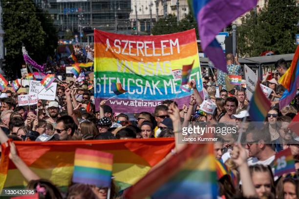 Demonstrators march during the annual Pride parade on July 24, 2021 in Budapest, Hungary. Pride organisers say that the march is as much a rally in...