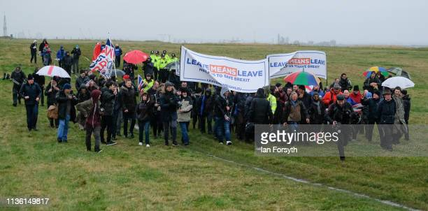 Demonstrators march during the first leg of the March to Leave demonstration on March 16 2019 in Sunderland England The first leg between Sunderland...