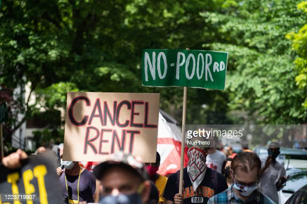 Demonstrators march for housing justice in the Old Town neighborhood in Chicago, IL on June 30 demanding a lift on the Illinois rent control ban and...